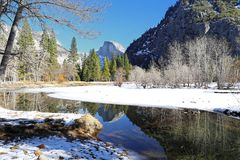 Yosemite National Park. Half Dome and its reflection in the Merced River (Yosemite National Park, California Stock Images