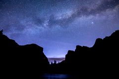 The Milky Way over Valley View. Yosemite National Park`s iconic El Capitan, Merced River, and mountain peaks are silhouetted as the stars and galaxies shine stock photo