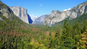 Yosemite national park view. Forest with mounatins and waterfalls in the background. royalty free stock images