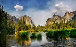 Yosemite National Park. Mountains reflection in Merced River. Yosemite Valley, CA. USA Royalty Free Stock Photography