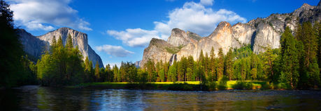 Yosemite Panorama. Panorama of El Capitan and the Cathedral Rocks/Bridalviel Falls with the Merced River flowing in front Royalty Free Stock Image