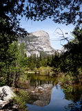 Yosemite rocks reflected in Mirror Lake stock image