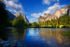 Yosemites Rocks and Merced River. El Capitan and the Cathedral Rocks (with Bridalviel Falls) at Yosemites Merced River Royalty Free Stock Images