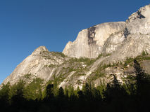 Yosemite: Under Half Dome. Looking up at Yosemite's Half Dome in early evening light stock photography