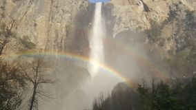 Yosemite Valley in all its glory - Double Rainbow at Bridalveil. Spectacular view of Bridalveil Falls with double rainbow at Yosemite Valley in Yosemite National royalty free stock image