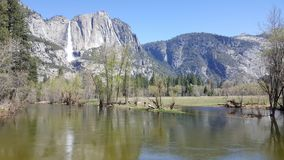 Yosemite Valley in all its glory - Yosemite Falls. Spectacular view of Yosemite Falls from Merced River at Yosemite Valley in Yosemite National Park in stock photos