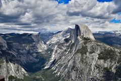 The Yosemite Valley and Half Dome. A Picturesque View of Yosemite Valley and Half Dome From Glacier Point royalty free stock photo