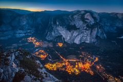 Yosemite Valley at night, California, USA. Panoramic aerial bird`s eye view of famous Yosemite Valley illuminated in beautiful post sunset twilight during blue royalty free stock photography