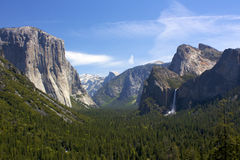Yosemite Valley Views. Yosemite Valley in California from Inspiration Point with Bridal Falls. The valley floor is covered in lush green trees and vegetation Royalty Free Stock Photo