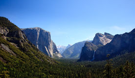 Yosemite Valley with waterfalls. Overview of Yosemite valley on clear blue sunny day stock photo