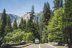 Summer car tour of the US natural parks. Tourist car in the Yosemite Valley Royalty Free Stock Image