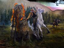 Yosemite Visitor Center, Native People, Tourism California. Native people in Yosemite - Men on horses set fire to the village, painting on the wall. Yosemite Stock Image
