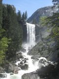 Yosemite Waterfall On A Clear Day. With water running down the rocks at Yosemite National Park Stock Image