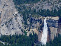 Yosemite Waterfall in Yosemite National Park. A waterfall in Yosemite National Park in California on a sunny day with blue skies taken from Glacier Point royalty free stock images