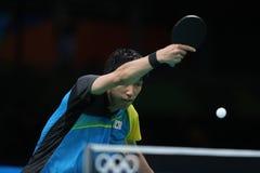 Yoshimura Maharu playing table tennis at the Olympic Games in Rio 2016. Yoshimura Maharu from Japan playing table tennis at the Olympic Games in Rio 2016 Stock Photo