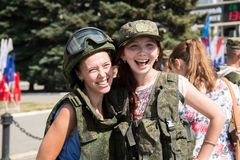 Young happy girls in military ammunition royalty free stock photography