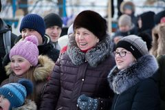 Smiling viewers on the Maslenitsa holiday. Yoshkar-Ola, Russia - February 19, Russia - Smiling viewers on the Maslenitsa holiday stock photography