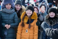 Smiling viewers on the Maslenitsa holiday. Yoshkar-Ola, Russia - February 19, Russia - Smiling viewers on the Maslenitsa holiday royalty free stock image