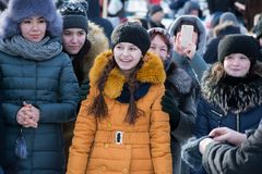 Smiling viewers on the Maslenitsa holiday. Yoshkar-Ola, Russia - February 19, Russia - Smiling viewers on the Maslenitsa holiday stock photos