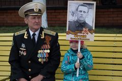 Colonel of the Russian Navy with his granddaughter. Yoshkar-Ola, Russia - May 9 Colonel of the Russian Navy with his granddaughter for the shares of the immortal Royalty Free Stock Photo