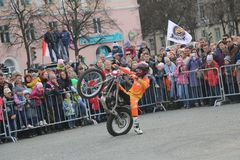 YOSHKAR-OLA, RUSSIA - MAY 5, 2018: Motoshow in the central square of the city. Tricks on a motorcycle, stuntmen, Stunt Riding stock photo