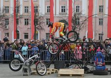 YOSHKAR-OLA, RUSSIA - MAY 5, 2018: Motoshow in the central square of the city. Tricks on a motorcycle, stuntmen, Stunt Riding. YOSHKAR-OLA, RUSSIA - MAY 5, 2018 Royalty Free Stock Image