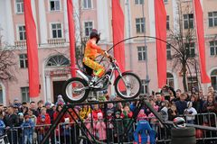 YOSHKAR-OLA, RUSSIA - MAY 5, 2018: Motoshow in the central square of the city. Tricks on a motorcycle, stuntmen, Stunt Riding. YOSHKAR-OLA, RUSSIA - MAY 5, 2018 Royalty Free Stock Photo