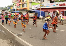 Yospan Dance on Art and Cultural Festival 2017. Yospan Dance - Yosim Pancar - from Biak on a parade. The couple in front of is considered as the best dancers and Royalty Free Stock Photography