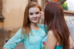"""You're my best friend"". Two young girl kissing. Urban bac Stock Photos"