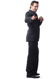 You!. Full length portrait of business man pointing to you with both hands over white background Stock Photo