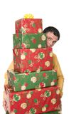 For you. A young handsome guy carrying a huge stack of christmas presents Stock Photos