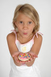 For You. A child takes a bite of a cookie coated in icing and sprinkles. Can be used for dentists and cavities. Teaching children about healthier diets. Child on Stock Photos