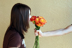 For you. A teen girl smelling roses given to her stock images