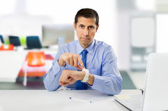 You arrive too late at the work. Businessman angry and pointing his watch as concept of arrive late at the work Royalty Free Stock Images