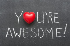 You are awesome. Exclamation handwritten on chalkboard with heart symbol instead of O stock photography