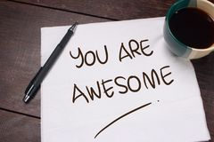 You Are Awesome. Motivational text. You Are Awesome. Motivational inspirational quotes words. Wooden background royalty free stock photos
