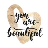 You are beautiful - black lettering with golden heart. royalty free illustration