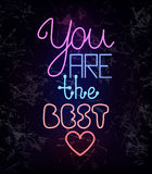 You are the best, glowing neon light wire text. You are the best, colorful glowing neon light wire lettering on black textured background. Compliment for a Royalty Free Stock Photo