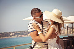 You are the best thing in my life. Portrait of a loving young couple standing and holding each other on the Promenade. Love in the sun. French Riviera royalty free stock image