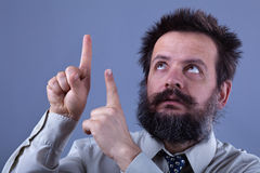 You better look up there - weird businessman pointing up Stock Photography