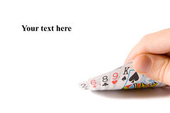 Are you bluffing?. Hand holding lousy cards - isolated Stock Photography