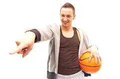 You can be the next. A smiling basketball player holding a orange ball and pointing his finger on someone Royalty Free Stock Image