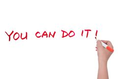 You can do it. ��You can do it!�� words written on white board Stock Photo