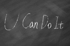You can do it phrase on blackboard. You can dot it phrase handwritten with white chalk on blackboard Stock Photos