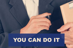 You can do it quotes - Business man background Royalty Free Stock Image