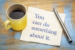You can do something about it. Handwriitng on napkin with a cup of coffee Stock Photography