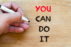 You can do it text concept. Human hand over wooden background and you can do it text concept stock photos