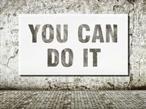 You can do it, words on wall royalty free stock images