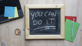 You can do it. Written on a chalkboard at the office royalty free stock image