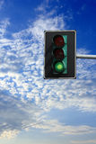 You can go: green light on traffic lights. Green sign on suspended traffic lights Royalty Free Stock Photography